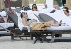 http://img206.imagevenue.com/loc490/th_312314441_Mischa_Barton_Bikini_Candids_on_the_Beach_in_Miami_December_27_2011_168_122_490lo.jpg